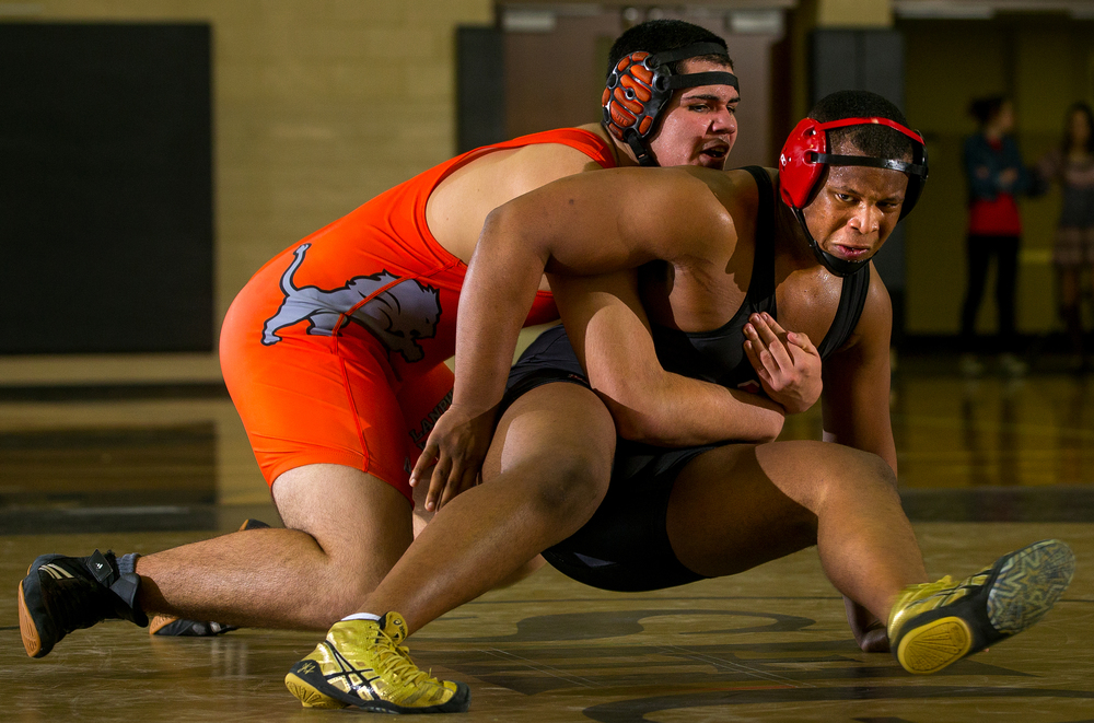Springfield's Terrion Taborn escapes from Lanphier's Brayan Reyes in the 220 pound bout of the 2016 Springfield Wrestling Tournament at Jim Belz Gymnasium at Sacred-Heart Griffin Friday, Jan. 15, 2016. Ted Schurter/The State Journal-Register