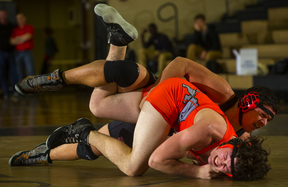 Springfield's Damien Elfgen drives Lanphier's Griffin Morris into the matt during the 2016 City Wrestling Tournament at Jim Belz Gymnasium at Sacred-Heart Griffin Friday, Jan. 15, 2016. Ted Schurter/The State Journal-Register