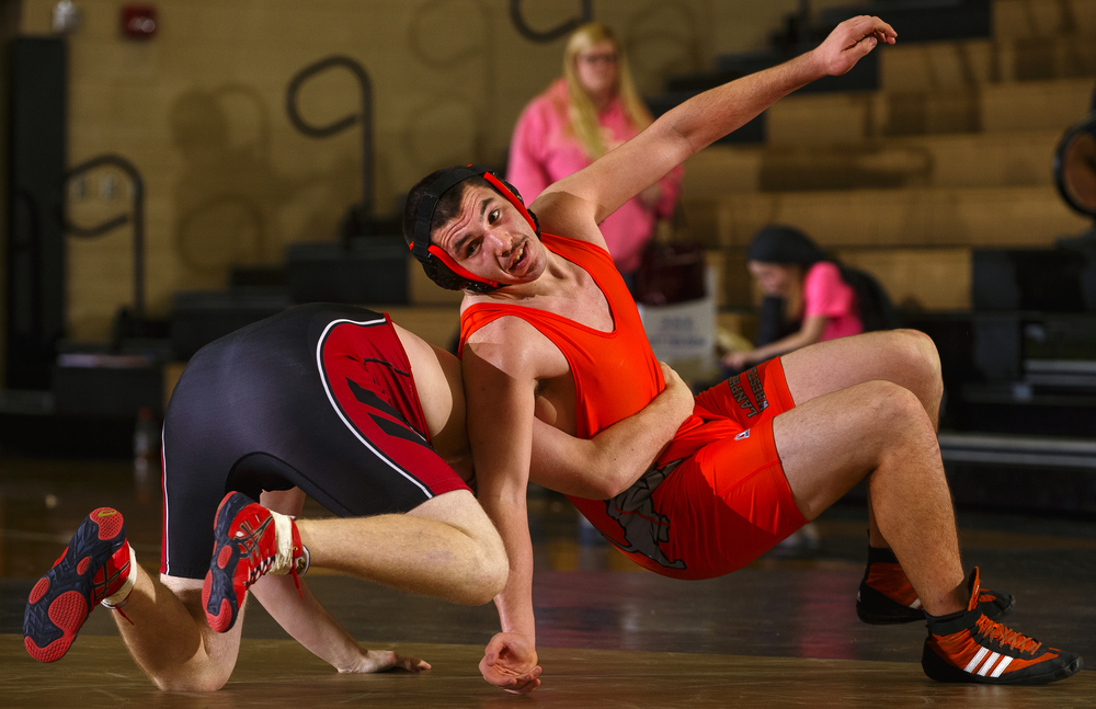 Lanphier's Chase Marshall escapes from Dalton Robison during the Springfield City Wrestling Tournament at Jim Belz Gymnasium at Sacred-Heart Griffin Friday, Jan. 15, 2016. Ted Schurter/The State Journal-Register