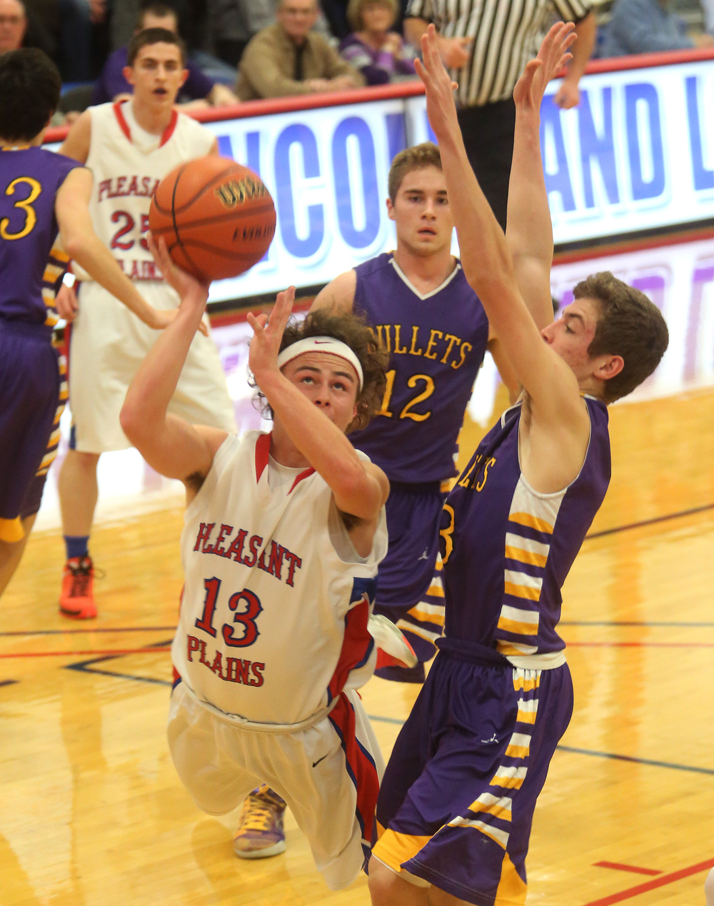 Pleasant Plains player Cole Greer goes airborne while putting up a shot during first half action while defended by Williamsville player Brandon Bunger. David Spencer/The State Journal Register