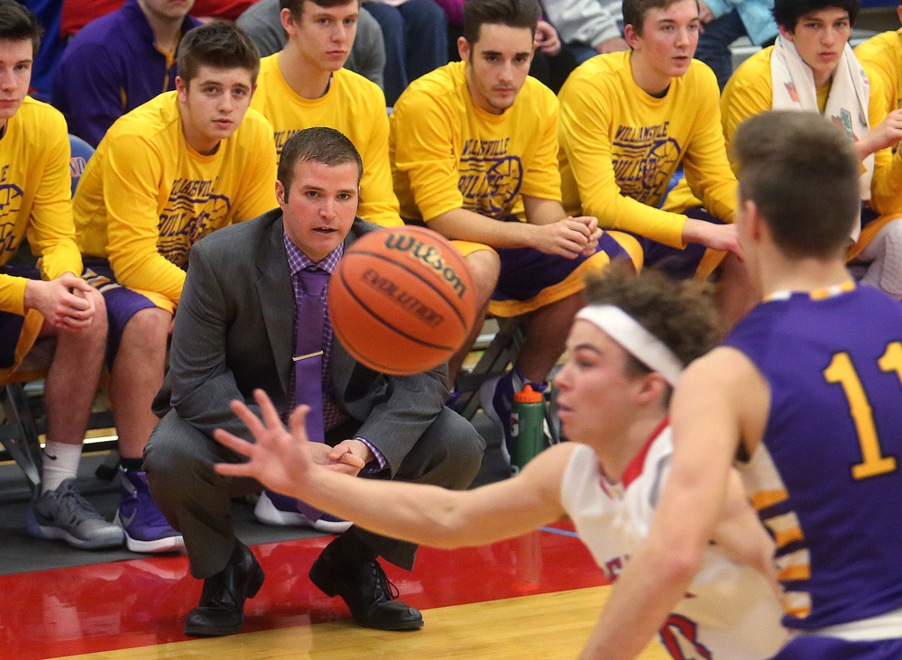 Williamsville head coach Nick Beard watches Pleasant Plains player Cole Greer going for a loose ball from the sidelines during first half action Saturday night. David Spencer/The State Journal Register
