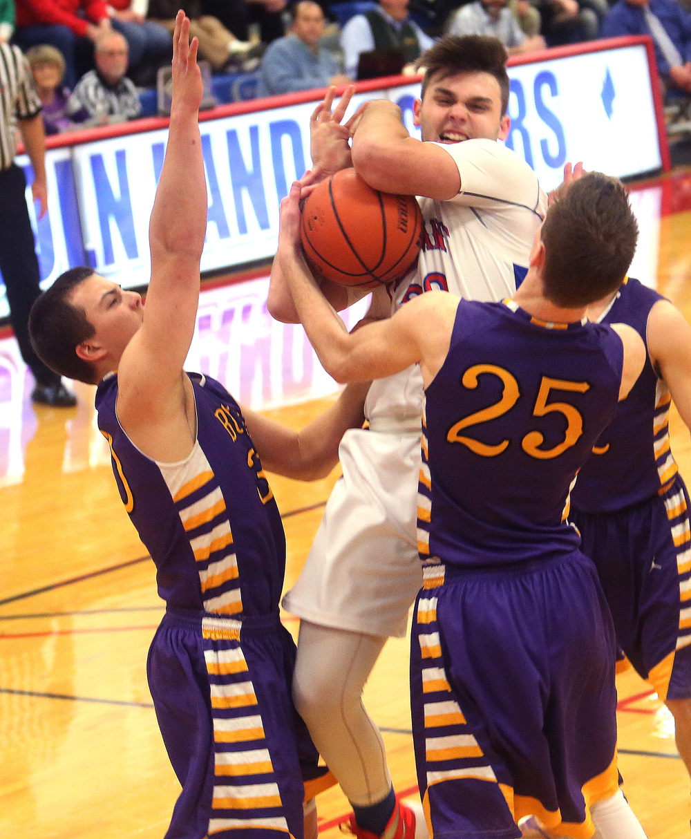 Pleasant Plains player Austin Finley grabs a rebound during the first half. . David Spencer/The State Journal Register