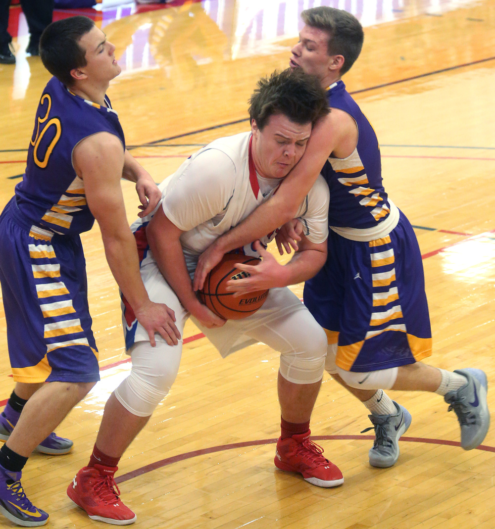 Plains player Nik Clemens fights for control of the ball. David Spencer/The State Journal Register