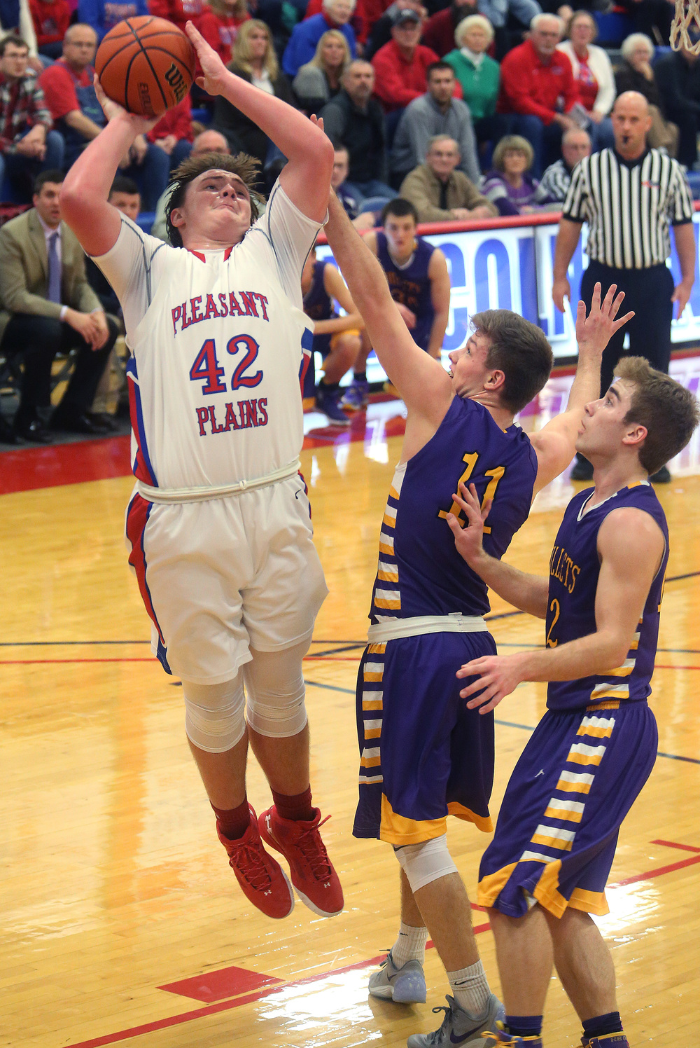 Plains player Nik Clemens goes airborne while putting up a shot. David Spencer/The State Journal Register