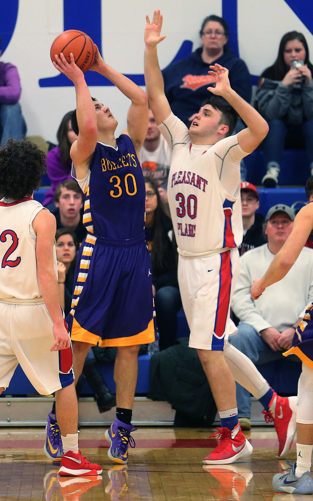 Williamsville player Jon Beal tries to shoot over Plains defender Austin Finley in the second half. David Spencer/The State Journal Register