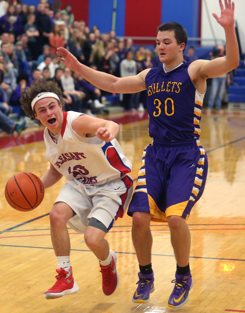 Plains player Cole Greer looks to put up two late in the game while defended by Williamsville player Jon Beal. David Spencer/The State Journal Register
