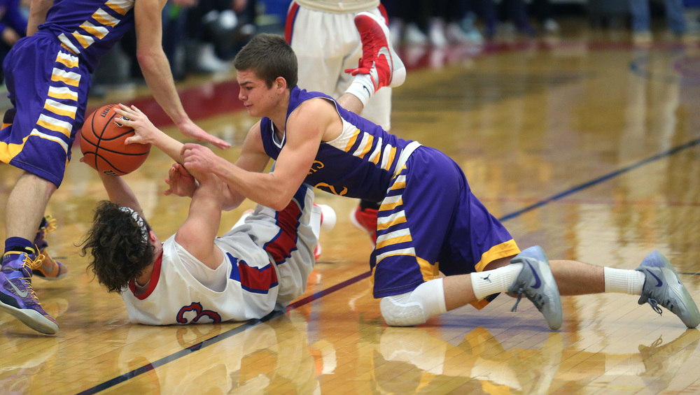 Williamsville player Zack Dellert tries to strip the ball from Plains player Cole Greer in the second half. David Spencer/The State Journal Register