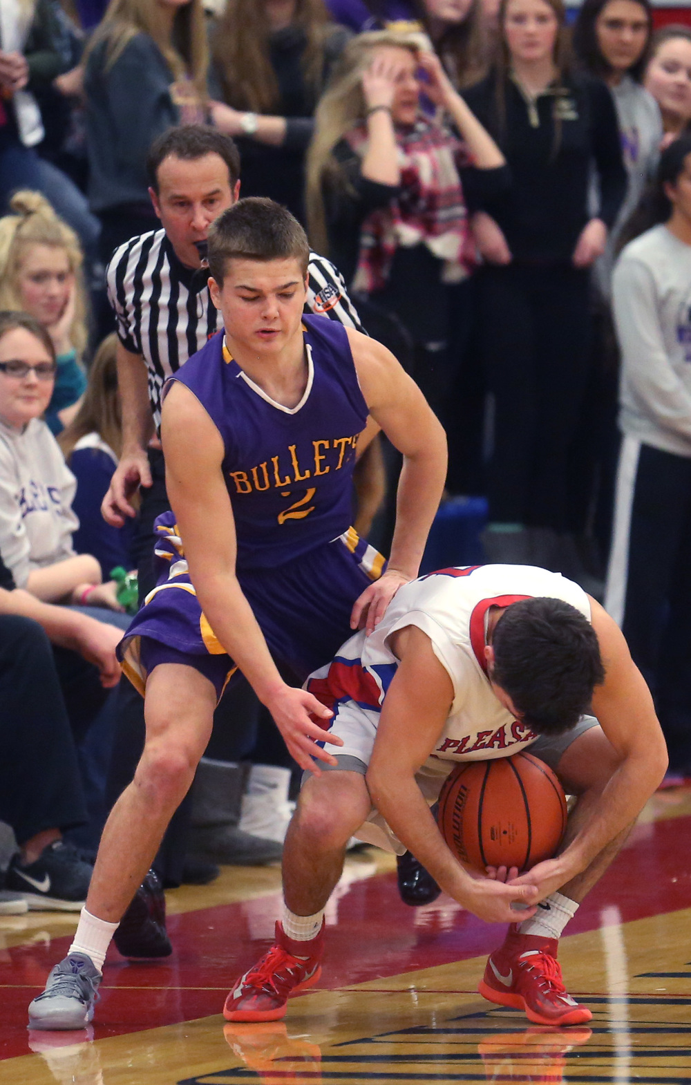 Plains player Aden Sachs keeps control of the ball late in the game while Williamsville player Zack Dellert defends. David Spencer/The State Journal Register