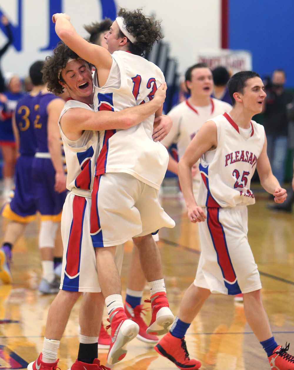 Cardinal players Daulton Nibbe at left embraces teammate Cole Greer seconds after their team defeated the Bullets. David Spencer/The State Journal Register