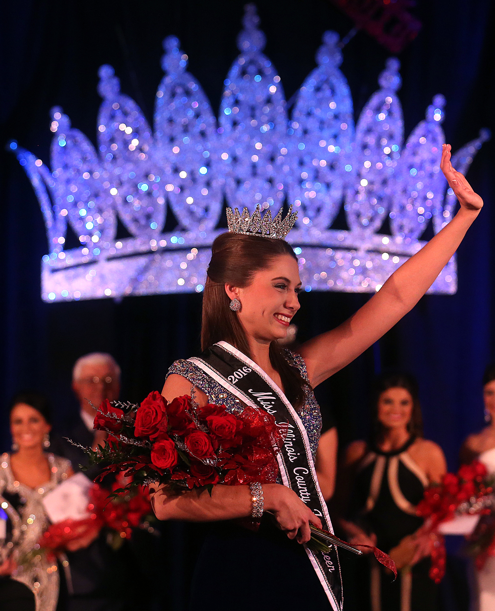 2016 Miss Illinois County Fair queen Abby Foster waves while she walks on the runway while acknowledging the audience Sunday evening. David Spencer/The State Journal-Register