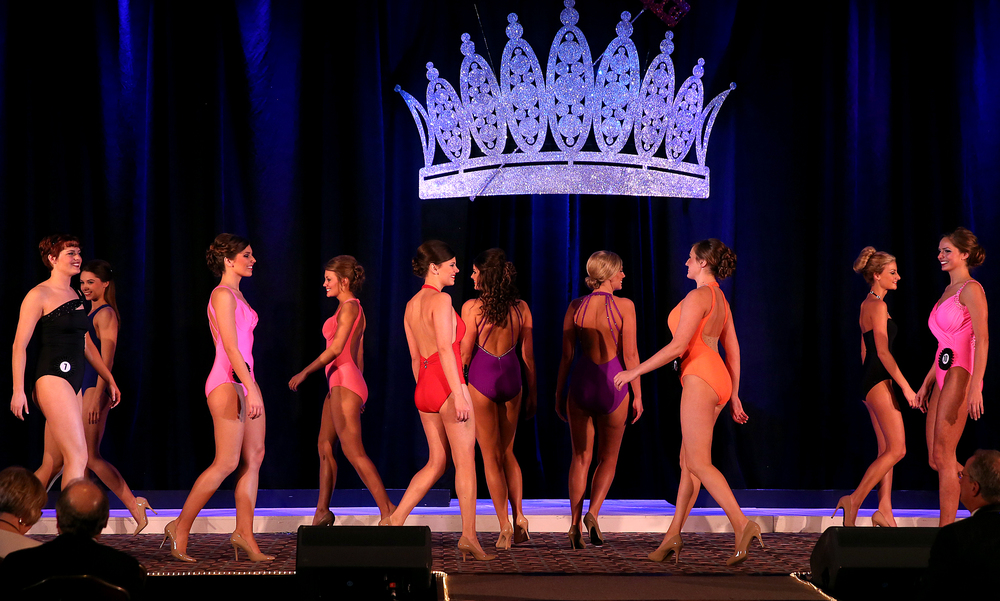 Some of the 15 finalists walk together onstage during the swimsuit portion of the judging Sunday evening. David Spencer/The State Journal-Register