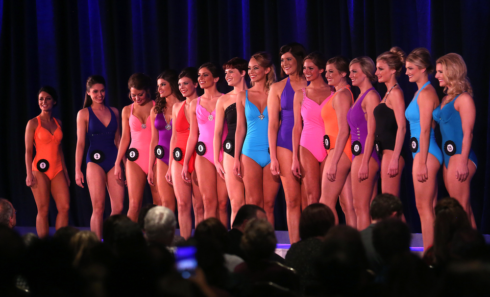 The 15 finalists stand together onstage during the swimsuit portion of the judging Sunday evening. David Spencer/The State Journal-Register