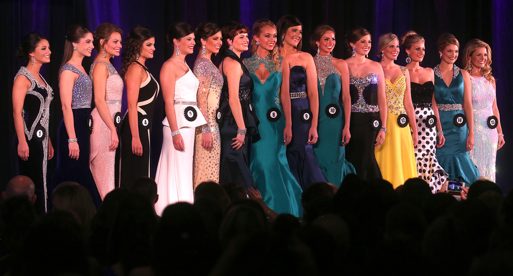 The 15 finalists taking part in the evening gown portion of the judging stand together onstage Sunday night. David Spencer/The State Journal-Register