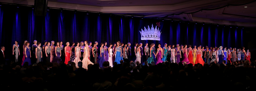 All 69 fair queens from throughout the state of Illinois take to the stage in their evening gowns Sunday night. David Spencer/The State Journal-Register