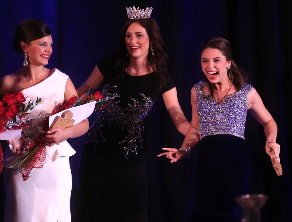 Abby Foster of Vermilion County at right is steadied by outgoing 2015 Miss Illinois County Fair Queen Sadie Gassmann after Foster was named 2016 Miss Illinois County Fair queen Sunday evening. David Spencer/The State Journal-Register