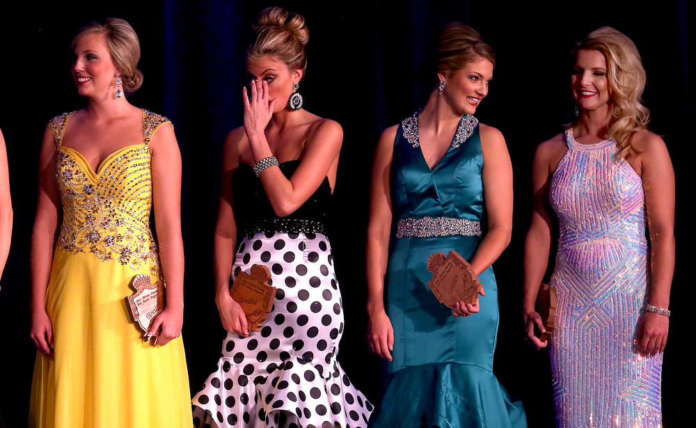 Several of the 15 finalists not named runners up stand together onstage at the conclusion of the pageant. From left to right: Richland County queen Carlea Pierce, Georgetown Fair queen Sierra Dicken, Moultrie-Douglas County queen Gabrielle Uphoff, Marion queen Karlie Nattier. David Spencer/The State Journal-Register