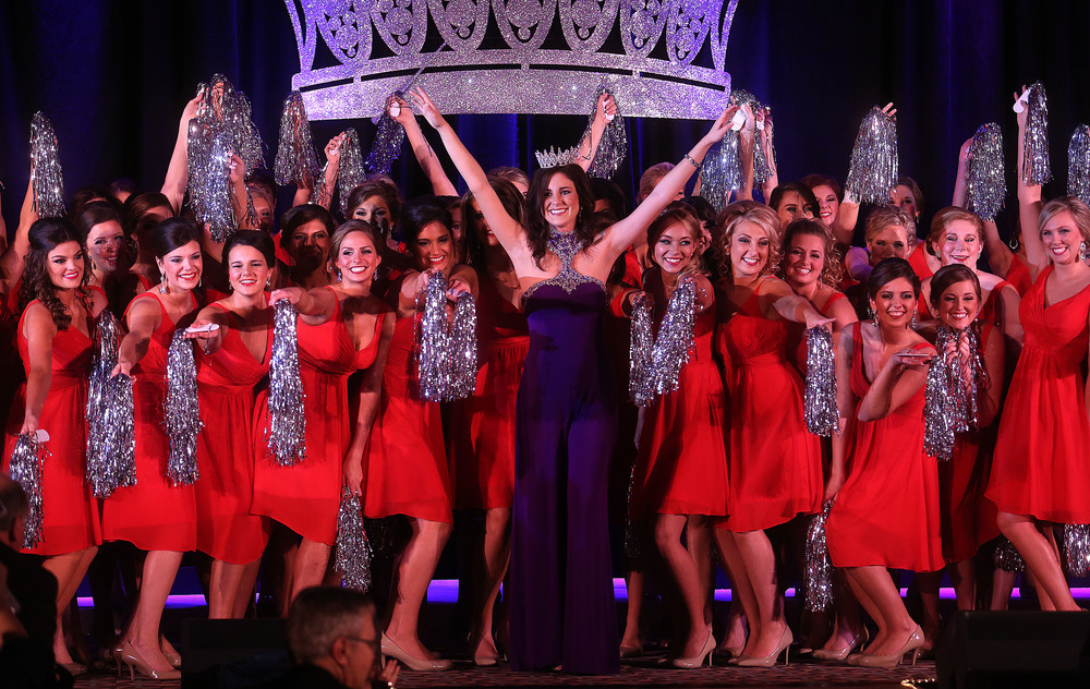 "Outgoing 2015 Miss Illinois County Fair Queen Sadie Gassmann at center concludes the opening production number ""That's What Makes You Beautiful"" along with some of the 2016 fair queen contestants onstage Sunday night. David Spencer/The State Journal-Register"