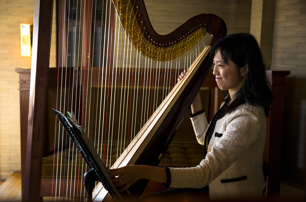 "Chen-Yu Huang, the principle harp of the Illinois Symphony Orchestra, performs ""Haiku for the Harp"" by Susann McDonald and Linda Wood on the harp during the Illinois Symphony Orchestra's Around the Town Concert Series in the Gallery Room of the Dana Thomas House, Tuesday, Jan. 12, 2016, in Springfield, Ill. The series continues on February 2nd with a performance by the groups Brass Quintet at The Pharmacy. Justin L. Fowler/The State Journal-Register"