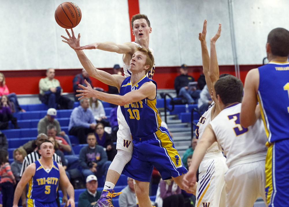 Tri-City's Devon Matthews gets past Williamsville's Harrison Creswell during the County Tournament at Lincoln Land Community College Tuesday, Jan. 12, 2016. Ted Schurter/The State Journal-Register
