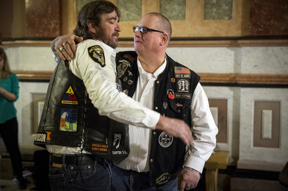 Army Veteran James Williams, left, gets a hug from Tony Schmidt, right, after the unveiling of the POW/MIA Chair of Honor during the Rolling Thunder Chapter 3 Illinois POW/MIA presentation in the rotunda of the Illinois State Capitol, Thursday, Jan. 14, 2016, in Springfield, Ill. Williams and Schmidt, both members of the Rolling Thunder, were on hand for the unveiling of the POW/MIA Chair of Honor to be put on display in the Capitol to honor the over 91,000 American soldiers that remain unaccounted for since World War I. Justin L. Fowler/The State Journal-Register