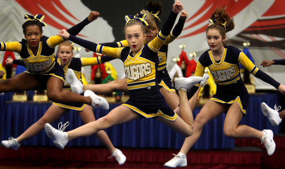 Members of the Carriel Jr. High School Cougars cheeerleading squad from O'Fallon, Ill take to the air during their performance before the judges Sunday morning. The 32nd Annual Illinois Cheerleading Coaches Association Championships concluded a two-day run on Sunday, Jan. 10, 2016 at Springfield's Prairie Capital Convention Center with competition featuring cheerleading squads from Junior High School teams from throughout the state of Illinois.  David Spencer/The State Journal-Register