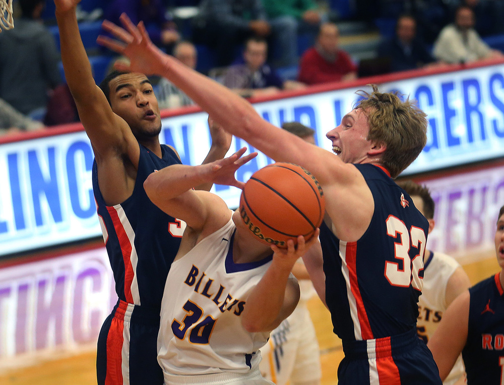 Williamsville player Jon Beal is sandwiched by Rochester defenders Collin Stallworth at left and Matt McClintock under the basket during first half action. Williamsville defeated Rochester 40-38 to win the semifinal game of the Sangamon County Boys Basketball Tournament at Lincoln Land Community College Thursday, Jan. 14, 2016.  David Spencer/The State Journal Register