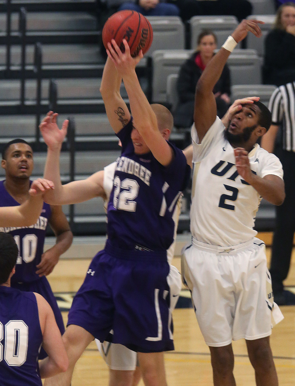 McKendree player Nate Michael grabs a rebound while UIS player Davi Austin gets an inadvertent hand to his face by teammate Paxton Harmon during the first half. David Spencer/The State Journal Register