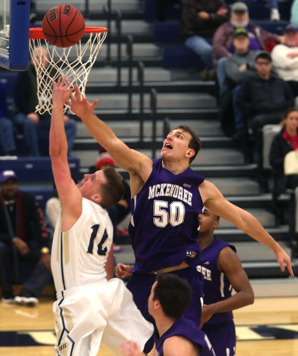 McKendree player David Newton goes up for a rebound against UIS player Vince Walker during the first half. David Spencer/The State Journal Register