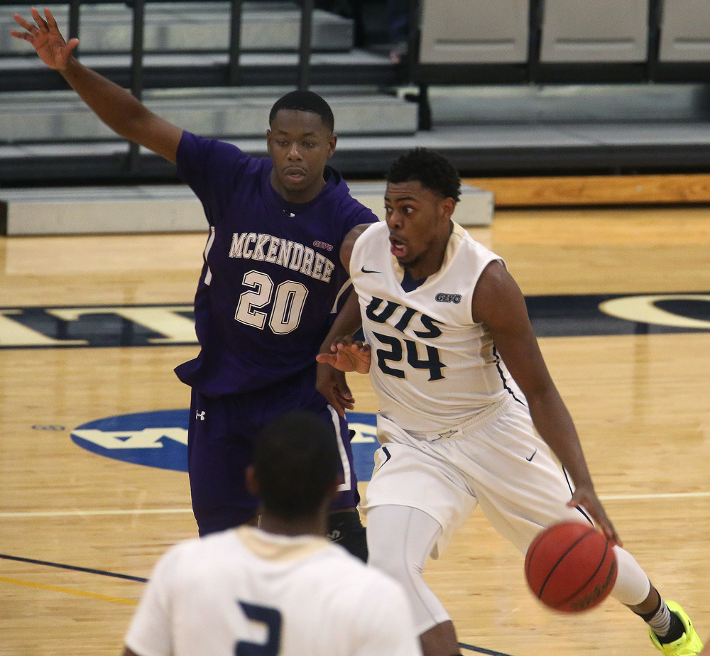 UIS player Jamall Millison drives against McKendree's Michael Jackson in the first half. David Spencer/The State Journal Register