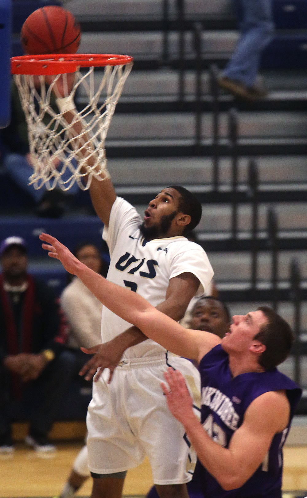 UIS player Davi Austin prepares to put in two points in the first half. David Spencer/The State Journal Register