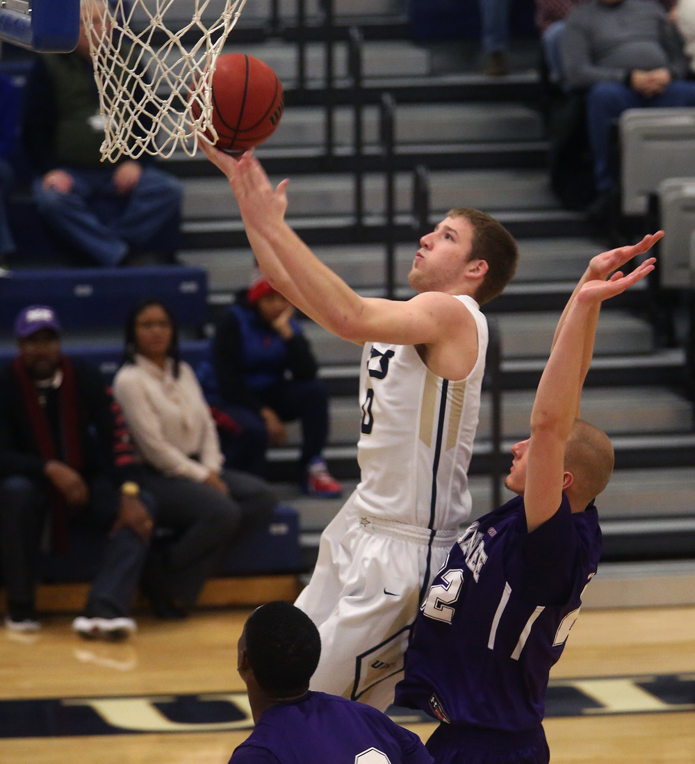 UIS player Paxton Harmon puts up two points. David Spencer/The State Journal Register