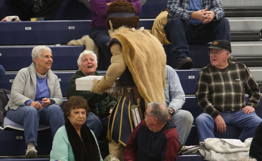 Some lucky UIS fans received free pizza personally delivered by Orion, the UIS mascot, during the game. David Spencer/The State Journal Register