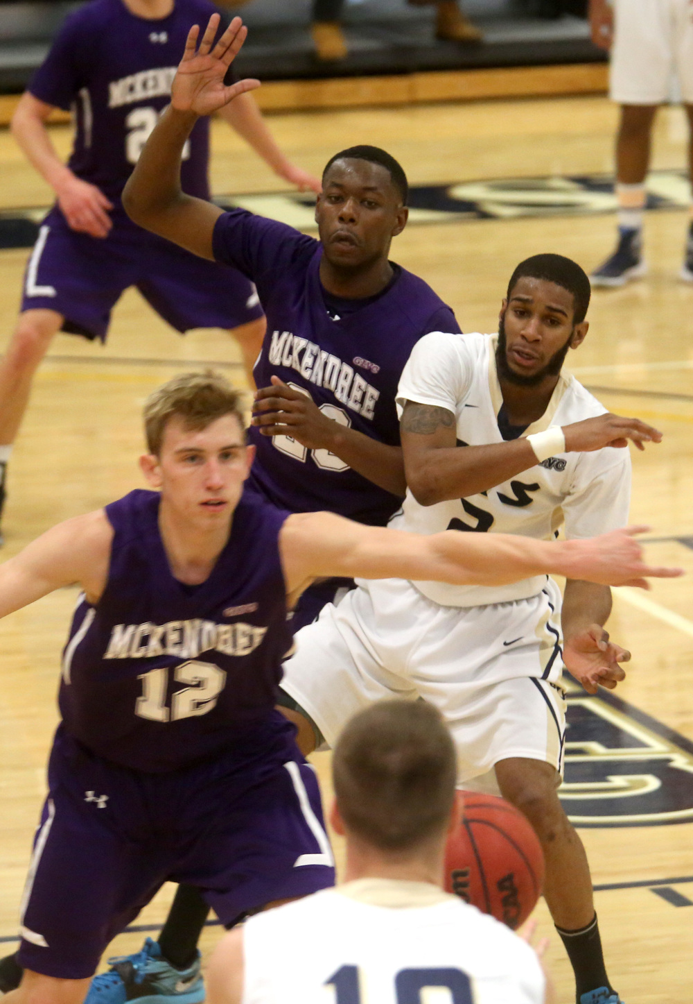 UIS player Davi Austin tries to stay open for a pass by teammate Vince Walker under heavy defense by McKendree. David Spencer/The State Journal Register