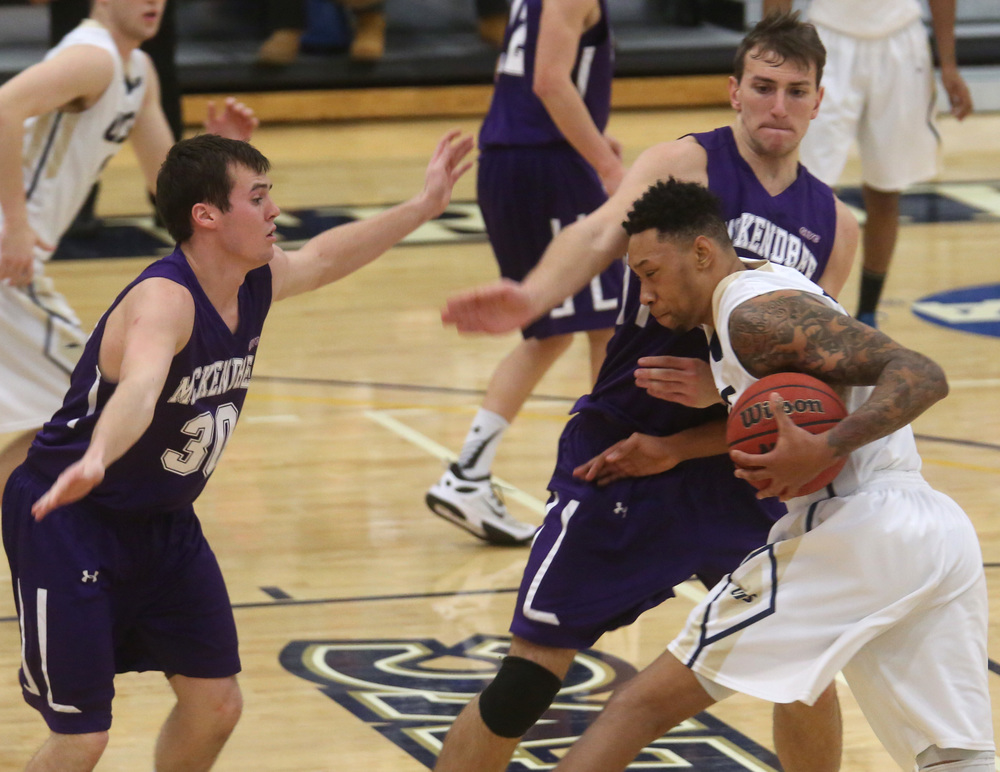 UIS player Richard Freeman runs into Mckendree defender David Newton. David Spencer/The State Journal Register