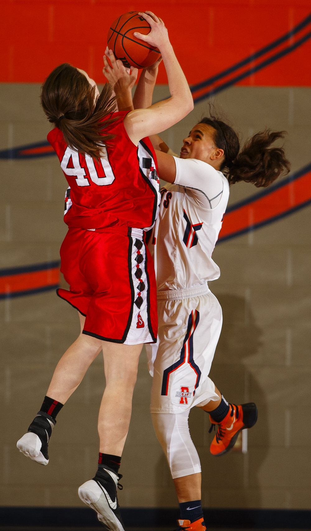 Springfield's Abby Ratsch crashes into Rochester's Lyric Boone on her way to the hoop at Rochester High School Tuesday, Jan. 19, 2016. Ted Schurter/The State Journal-Register
