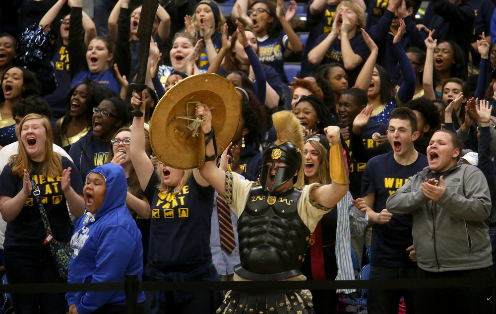Southeast High School Spartans mascot Colton Simpson leads the charge of the student cheering section during their game against Sacred Heart Griffin, which they won 62-48. The 68th annual City Boys Basketball Tournament kicked off on Thursday evening, Jan. 21, 2016 at Springfield's Prairie Capital Convention Center. David Spencer/The State Journal-Register