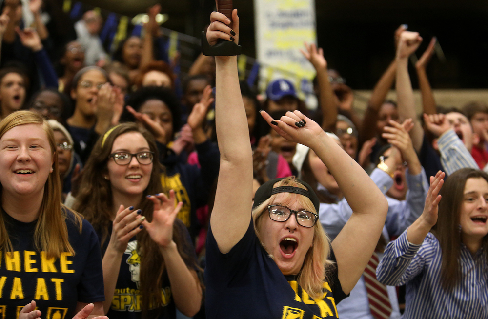 Springfield Southeast High School student Kayla Houston at center held aloft a large plastic sword while cheering the Spartans on with her fellow students Thursday night. The 68th annual City Boys Basketball Tournament kicked off on Thursday evening, Jan. 21, 2016 at Springfield's Prairie Capital Convention Center. David Spencer/The State Journal-Register