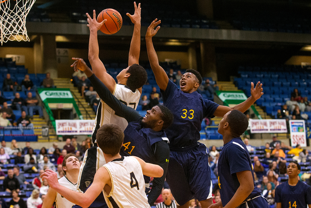 Sacred Heart-Griffin's Albert Okwuegbunam grabs a rebound in front of Southeast's Robert Hayes, left, and Mark Johnson during the City Tournament at the Prairie Capital Convention Center Thursday, Jan. 21, 2016. Ted Schurter/The State Journal-Register