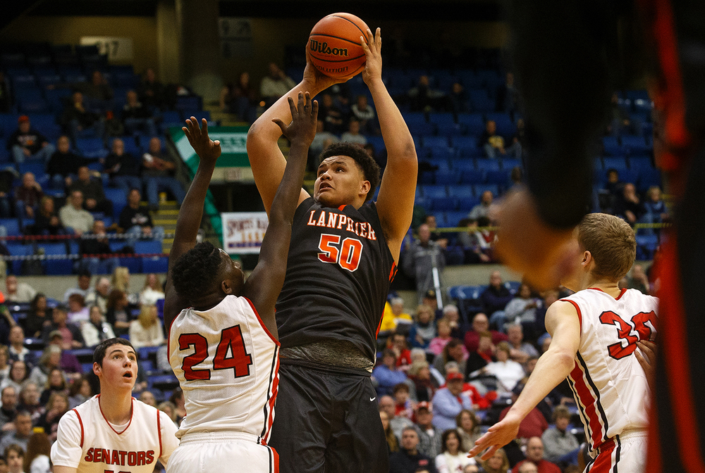 Lanphier's William Boles shoots in front of Springfield's Justin Pettis during the City Tournament at the Prairie Capital Convention Center Thursday, Jan. 21, 2016. Ted Schurter/The State Journal-Register