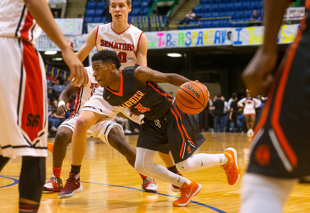 Lanphier's Xavier Bishop gets low as he drives to the basket against Springfield during the City Tournament at the Prairie Capital Convention Center Thursday, Jan. 21, 2016. Ted Schurter/The State Journal-Register