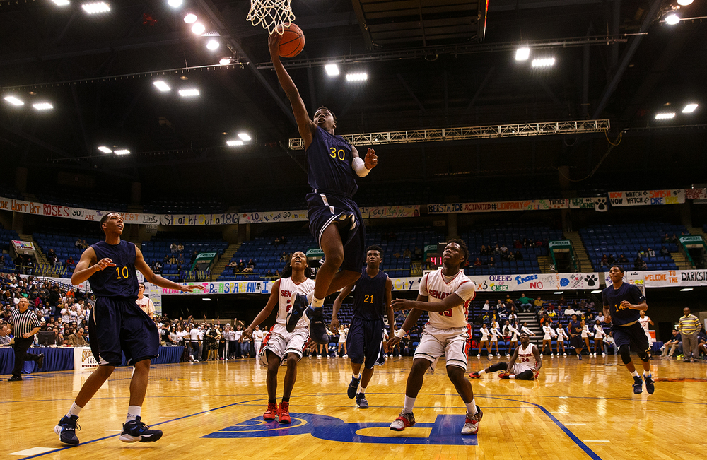 Southeast's D'Angelo Hughes lays in two points against Springfield during the City Tournament at the Prairie Capital Convention Center Friday, Jan. 22, 2016. Ted Schurter/The State Journal-Register