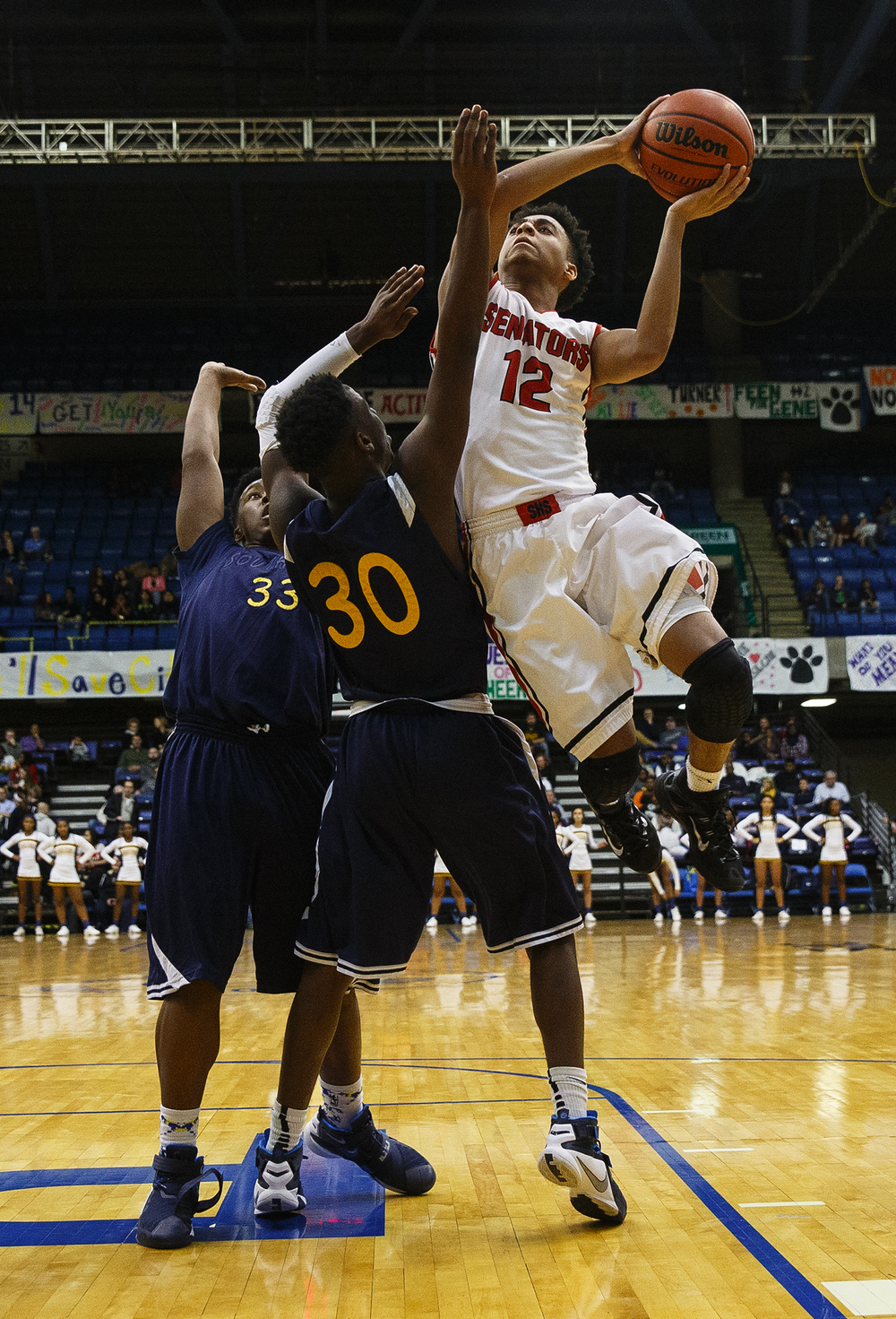 Springfield's Keon Day drives to the hoop against Springfield during the City Tournament at the Prairie Capital Convention Center Friday, Jan. 22, 2016. Ted Schurter/The State Journal-Register