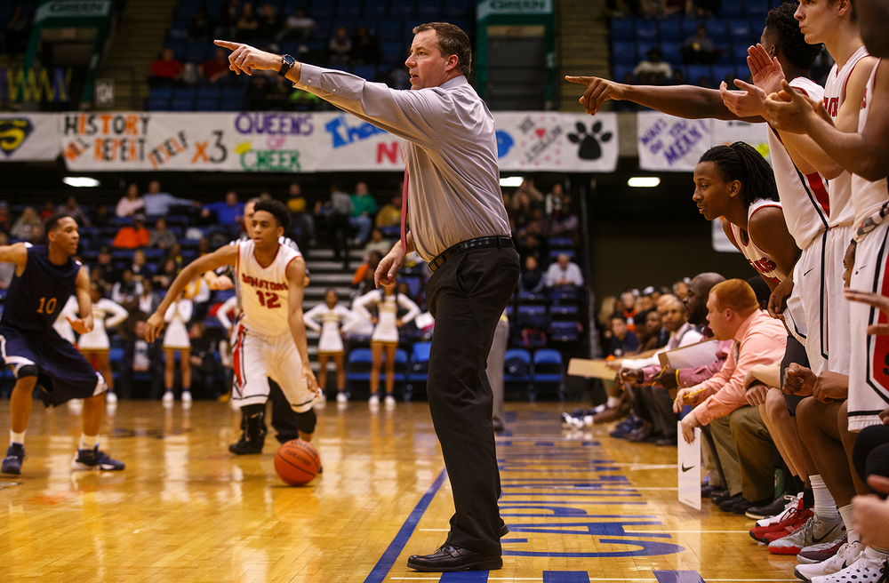 Springfield interim head coach Preston Snarr directs his team as they try to rally against Southeast in the finals seconds of the fourth quarter during the City Tournament at the Prairie Capital Convention Center Friday, Jan. 22, 2016. Ted Schurter/The State Journal-Register
