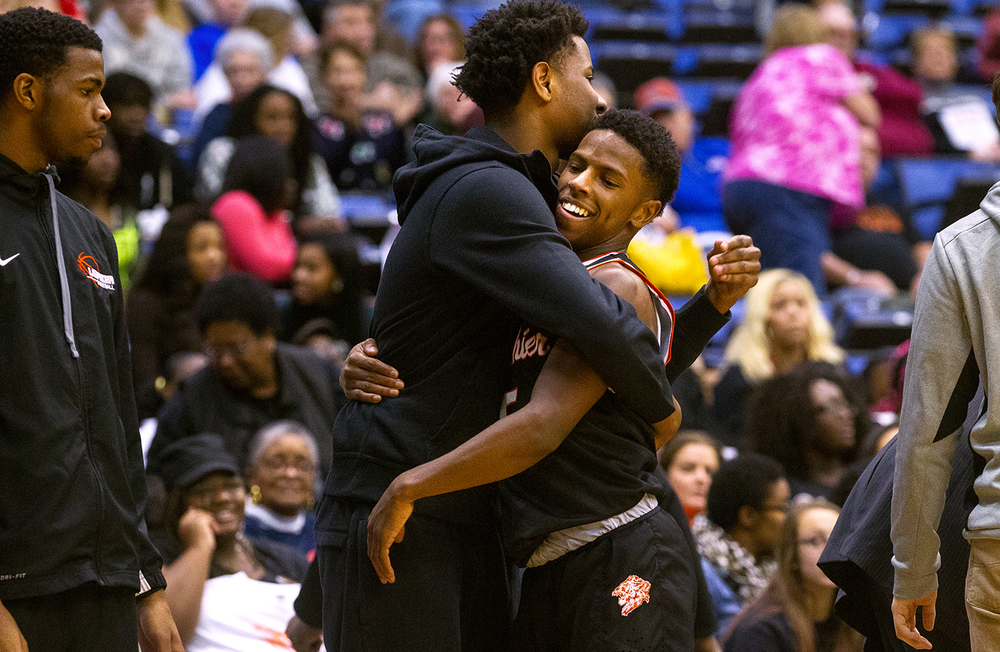 Lanphier's Xavier Bishop is congratulated by his teammates after scoring a record 50 points against Sacred Heart-Griffin during the City Tournament at the Prairie Capital Convention Center Friday, Jan. 22, 2016. Ted Schurter/The State Journal-Register