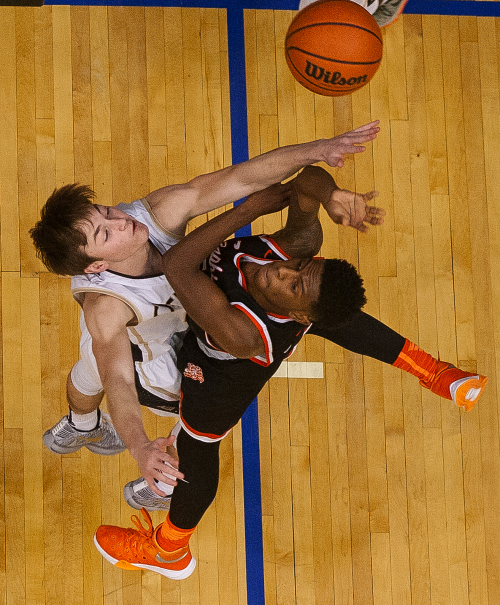 Lanphier's Xavier Bishop crashes into a Sacred Heart-Griffin defender during the City Tournament at the Prairie Capital Convention Center Friday, Jan. 22, 2016. Ted Schurter/The State Journal-Register