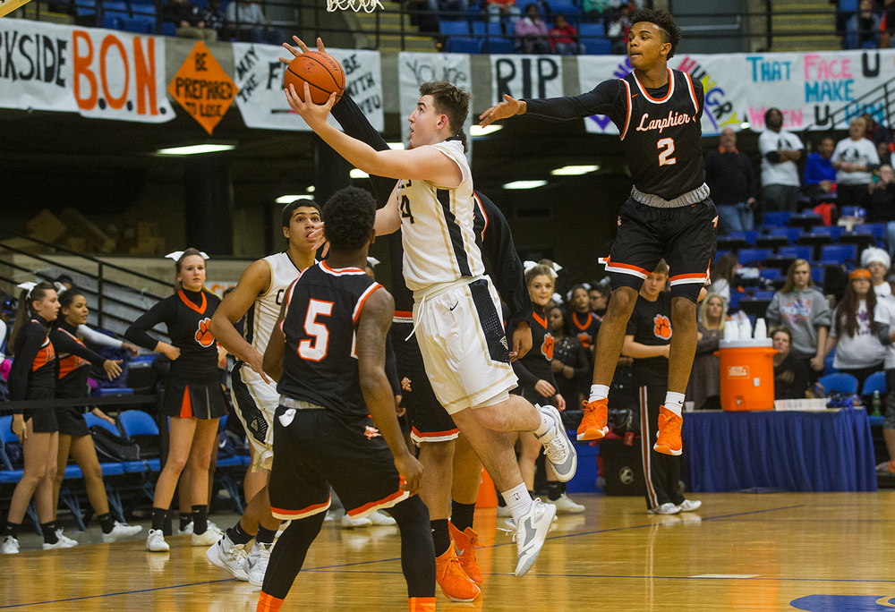Sacred Heart-Griffin's Nick Broeker drives past Lanphier's Cardell McGee during the City Tournament at the Prairie Capital Convention Center Friday, Jan. 22, 2016. Ted Schurter/The State Journal-Register