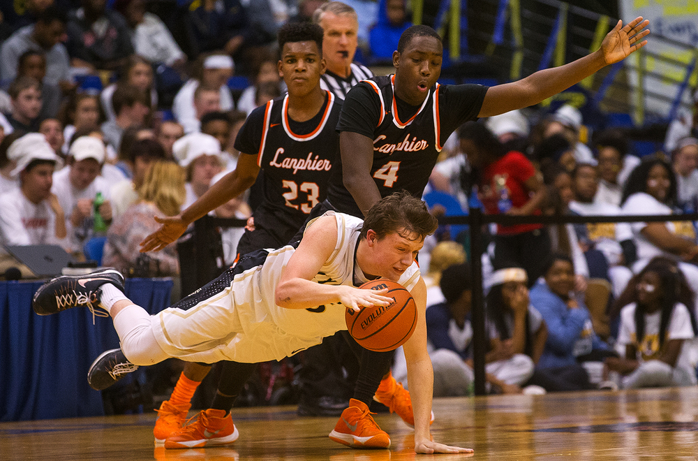 Sacred Heart-Griffin's Matt Moseley crashes to the floor as Lanphier's Corrington Jones defends during the City Tournament at the Prairie Capital Convention Center Friday, Jan. 22, 2016. Ted Schurter/The State Journal-Register
