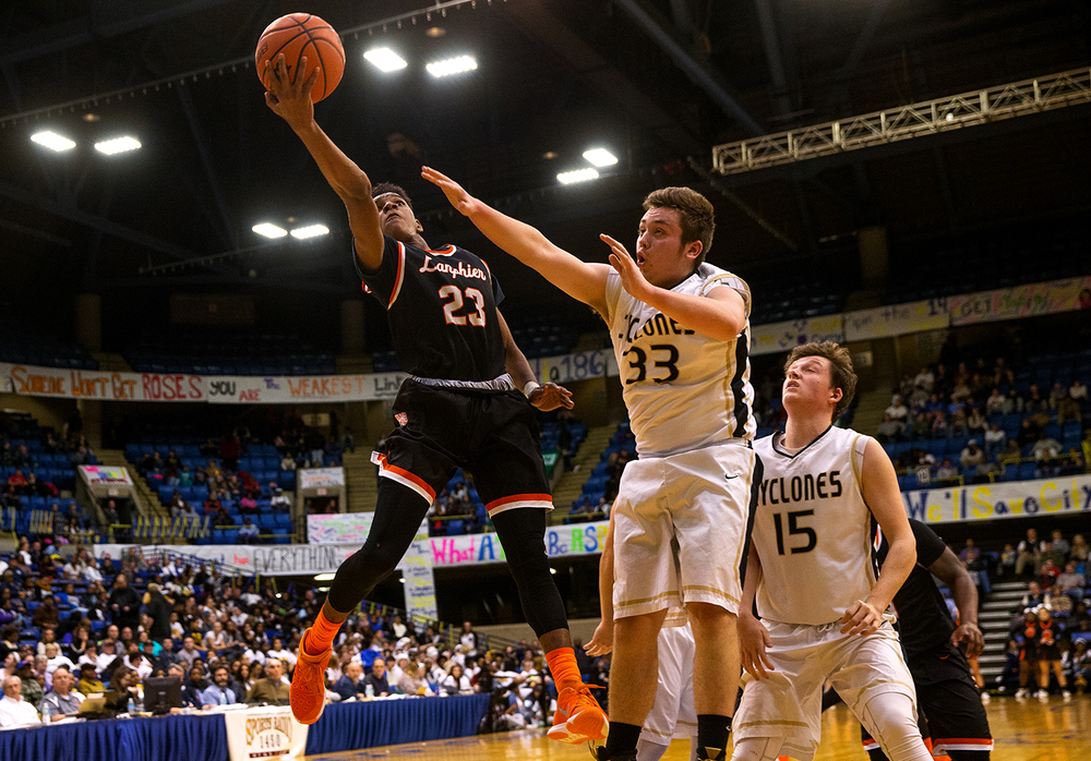 Lanphier's Aundrae Williams scores two in front of Sacred Heart-Griffin's Austin Chapman during the City Tournament at the Prairie Capital Convention Center Friday, Jan. 22, 2016. Ted Schurter/The State Journal-Register