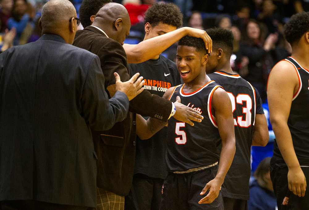 Lanphier's Xavier Bishop is congratulated as he comes off the floor after scoring a record 50 points against Sacred Heart-Griffin during the City Tournament at the Prairie Capital Convention Center Friday, Jan. 22, 2016. Ted Schurter/The State Journal-Register