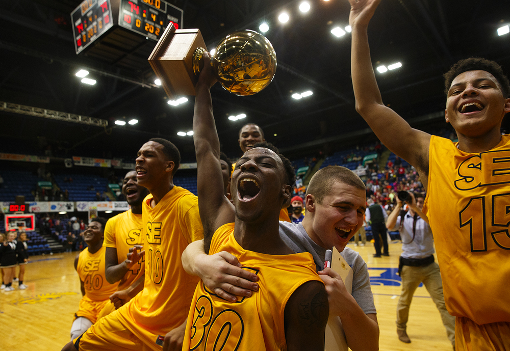 Southeast's D'Angelo Hughes hoists the City trophy after the Spartans defeated Lanphier 79-74 during the City Tournament championship game at the Prairie Capital Convention Center Saturday, Jan. 23, 2016. Ted Schurter/The State Journal-Register